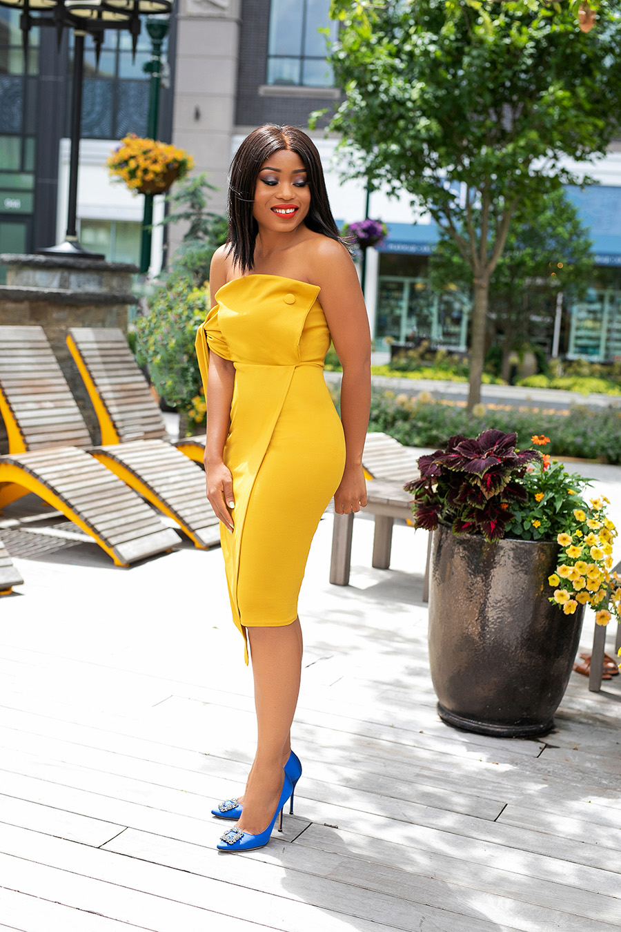 Midi yellow wedding guest dress and blue pumps