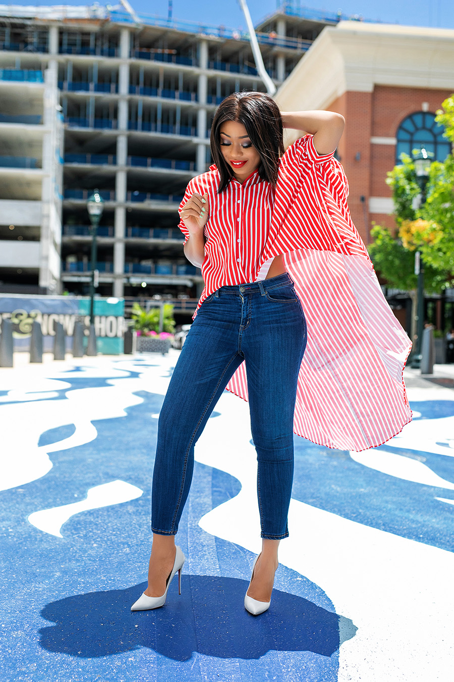 July fourth style in red and white long summer stripe shirt with blue jeans in the city