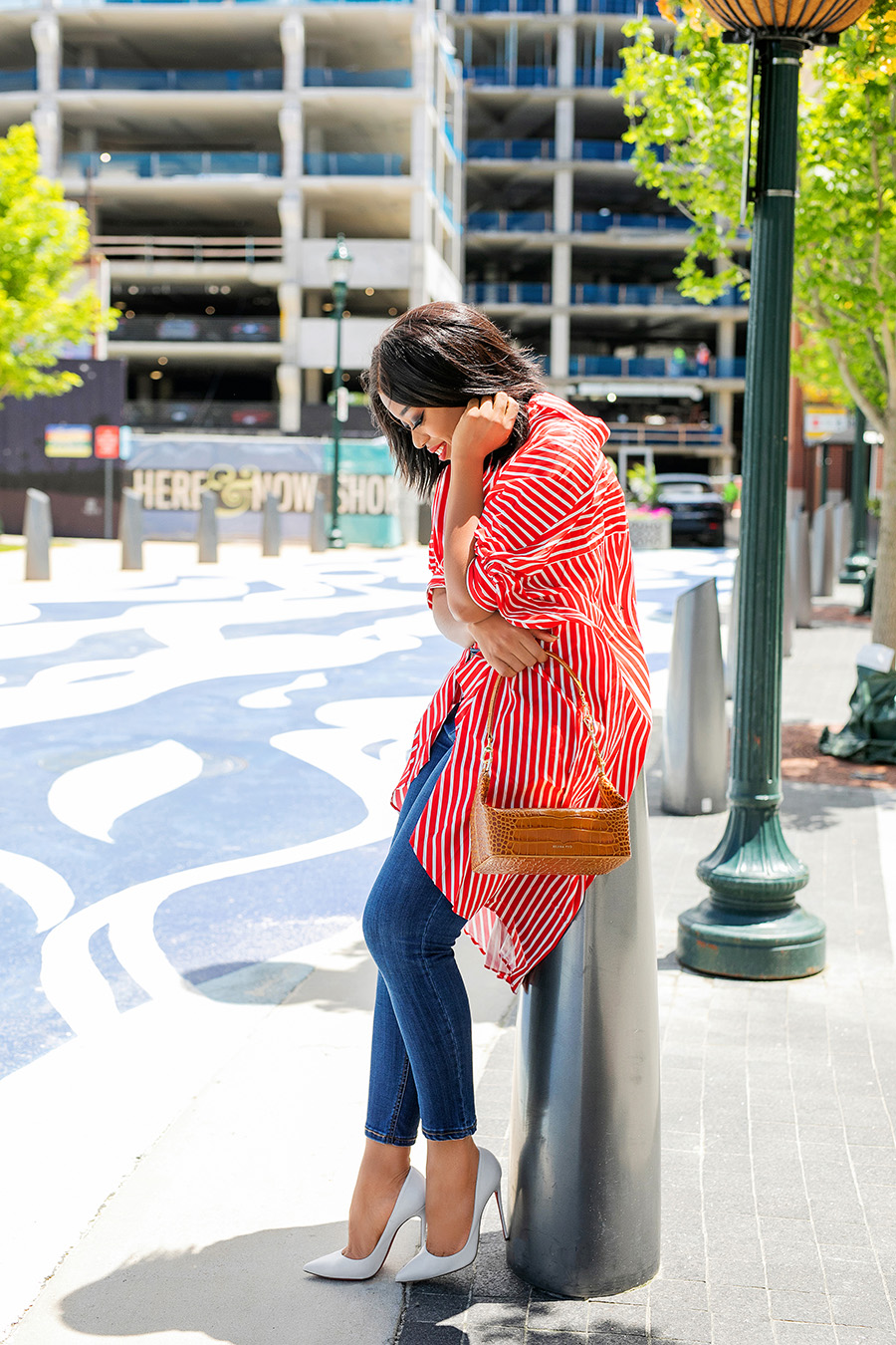 red and white long stripe shirt with blue jeans and white shoes for July fourth