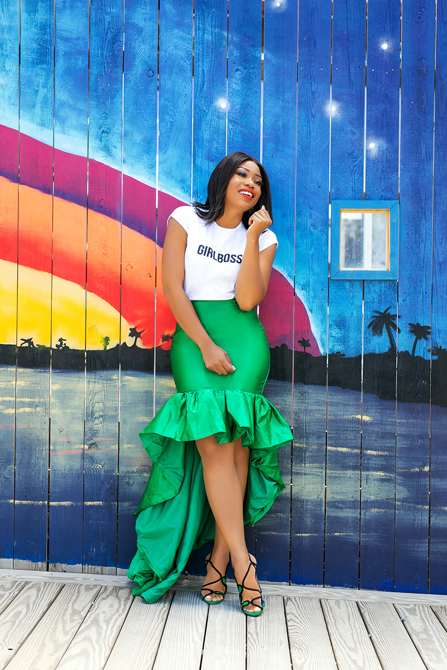Statement green skirt and graphic tee with a rainbow backdrop