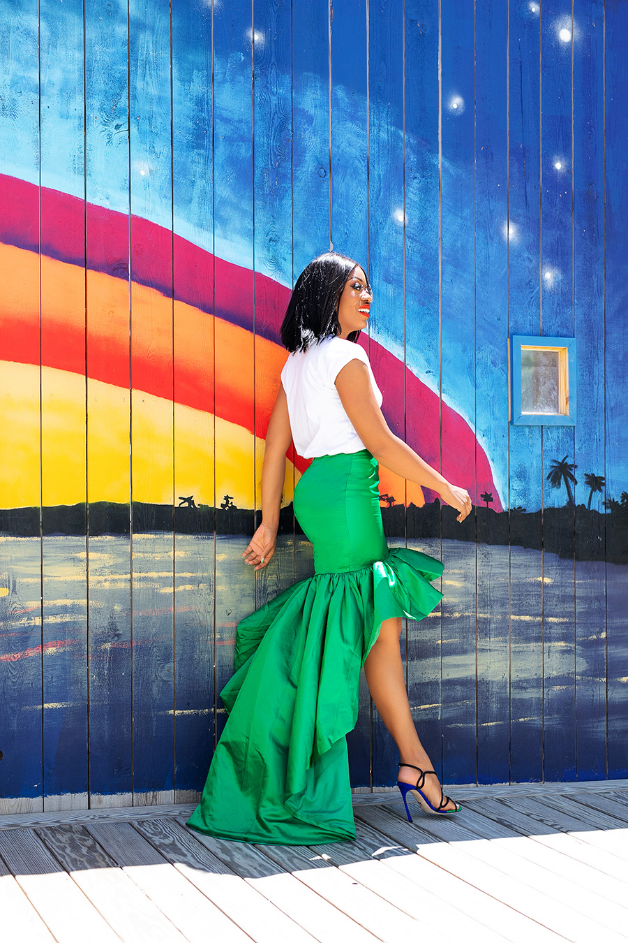 Wedding guest look in statement green skirt