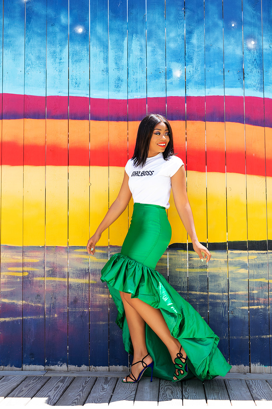 Wedding guest look in statement green skirt and graphic tee