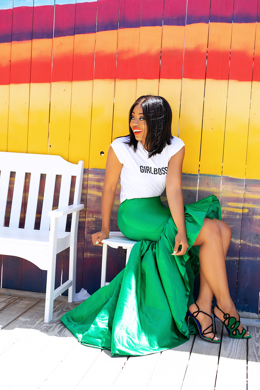 Wedding guest style in statement green skirt and graphic tee