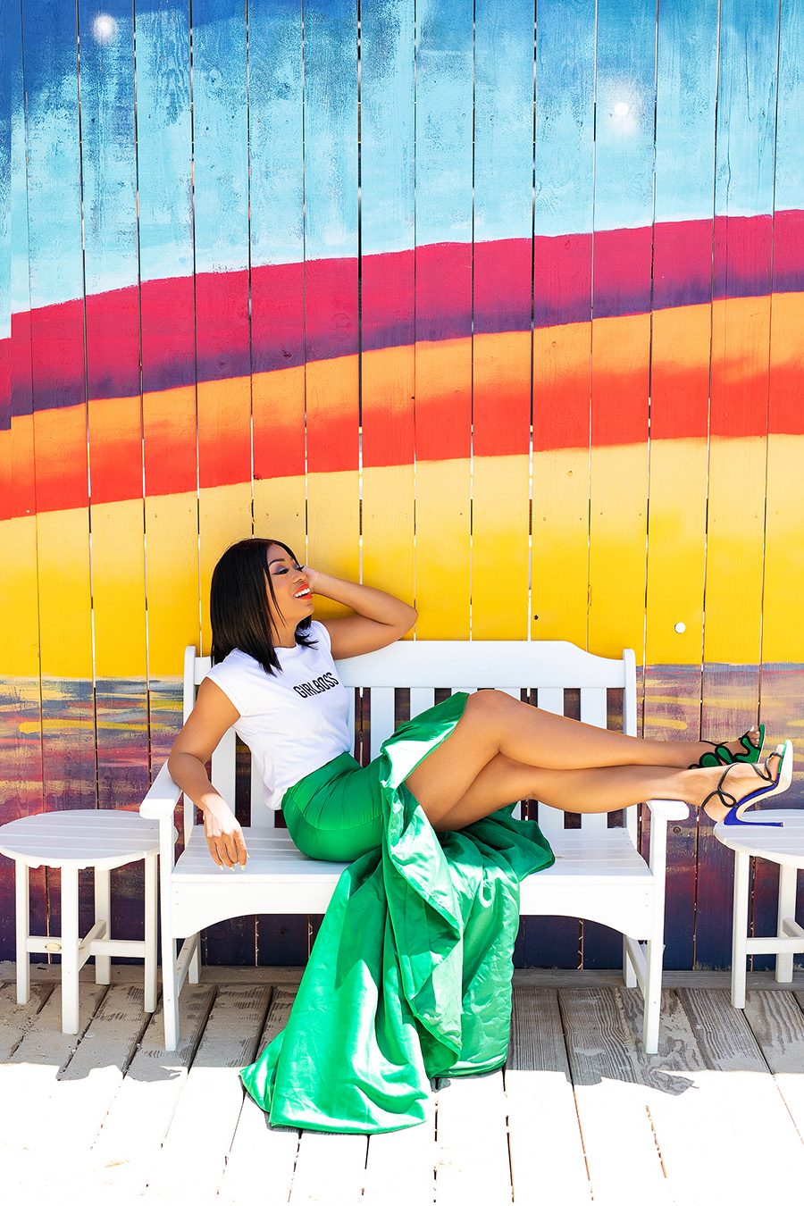 Statement green skirt and graphic tee with rainbow mural