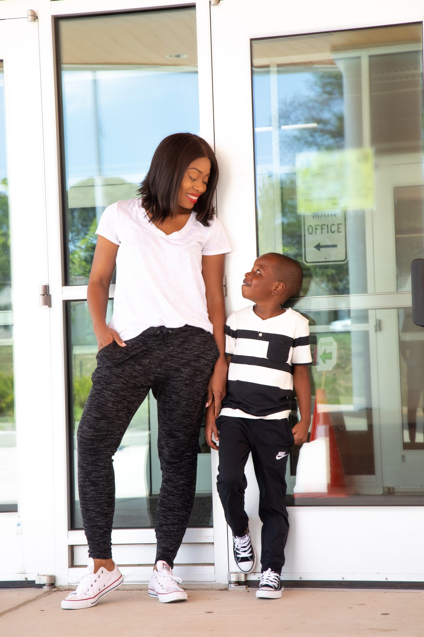 mom and son in joggers and converser for back to school