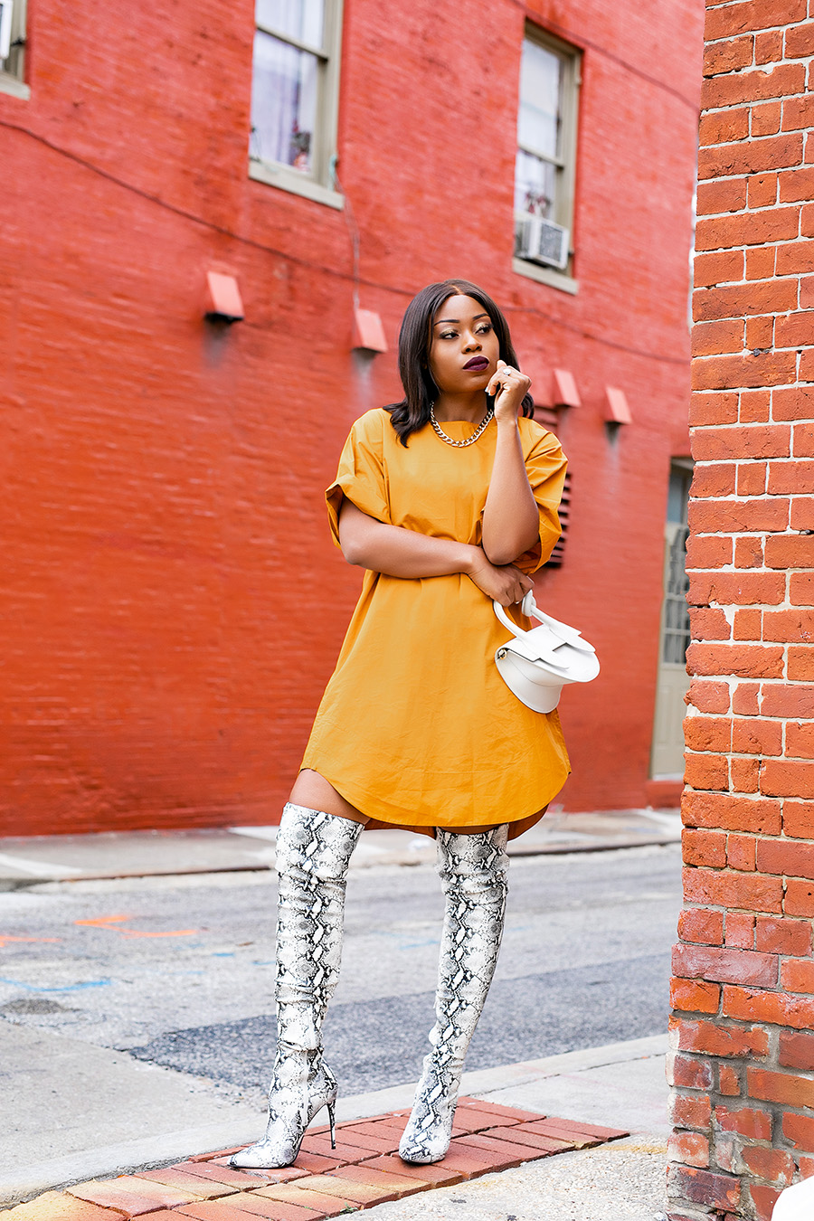 wear snake print boots and dress for fall