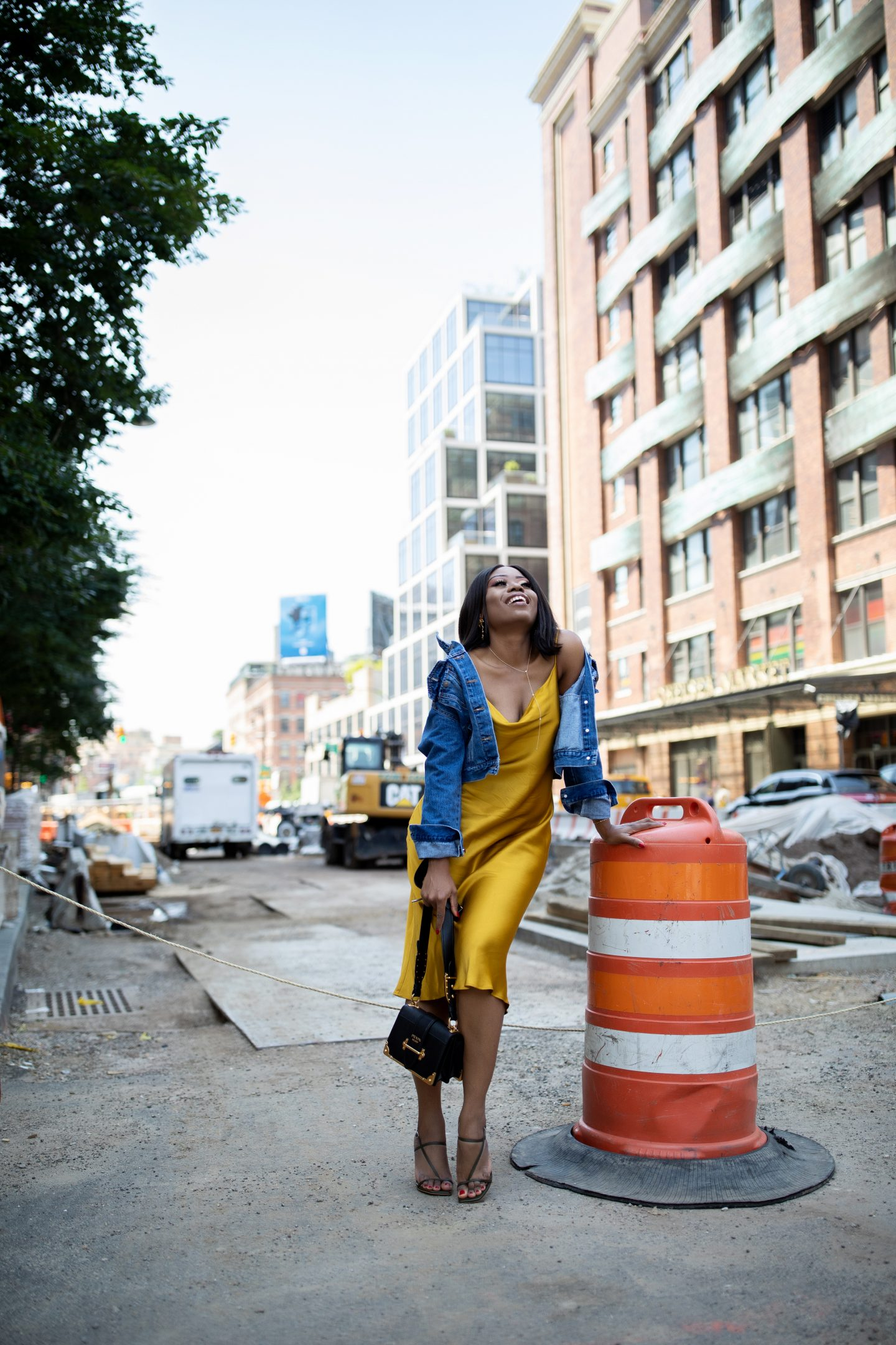 fashion blogger in slipdress and denim jacket in new york city