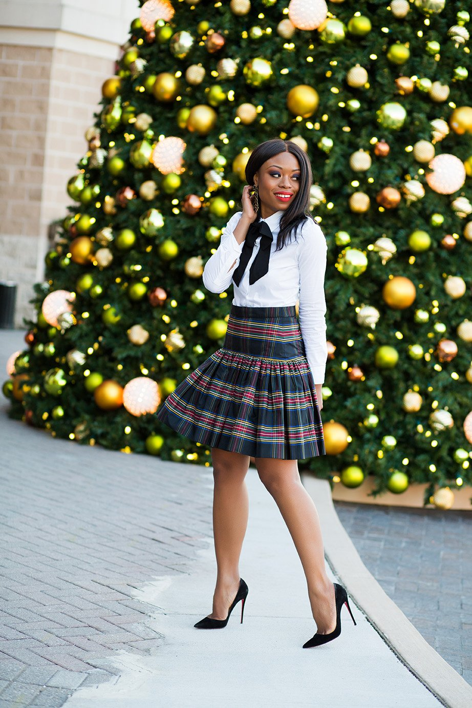 stella-adewunmi-in-jcrew-plaid-skirt-for-holiday-party