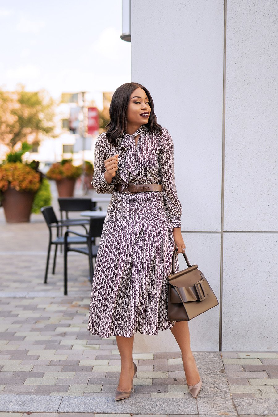 Stella-Adewunmi-of-jadore-fashion-shares-how-to-wear-pleated-dress-to-work-for-spring