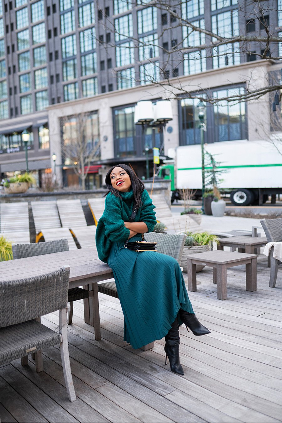 stella-adewunmi-of-jadore-fashion-blog-shares-how-to-wear-pleated-skirt-for-work-and-boots