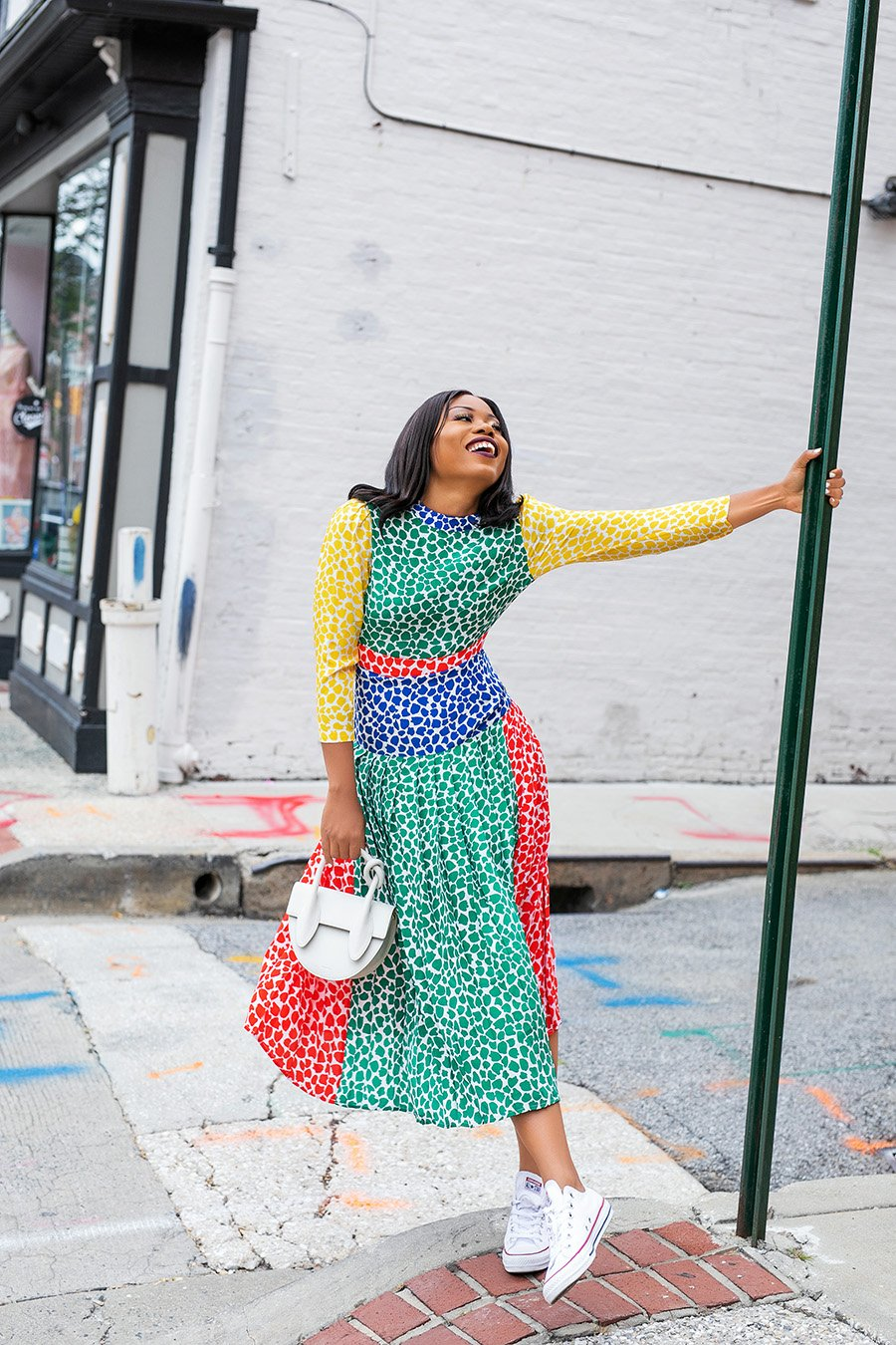 stella-adewunmi-of-jadore-fashion-blog-in-rixo-charlene-summer-dress-with-sneakers