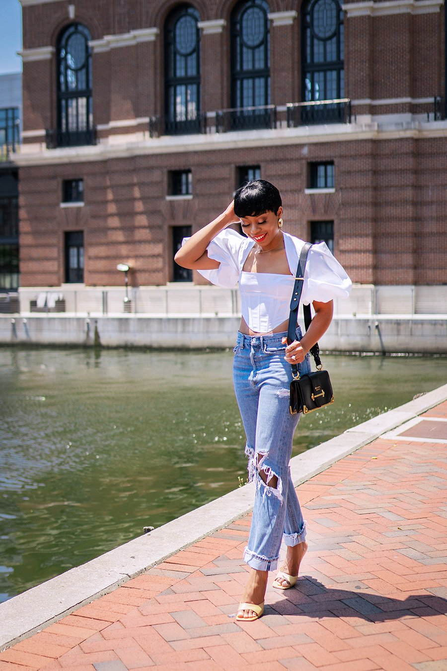 stella-adewunmi-of-jadore-fashion-blog-shares-easy-chic-way-to-style-distressed-agolde-jeans-statement-crop-top