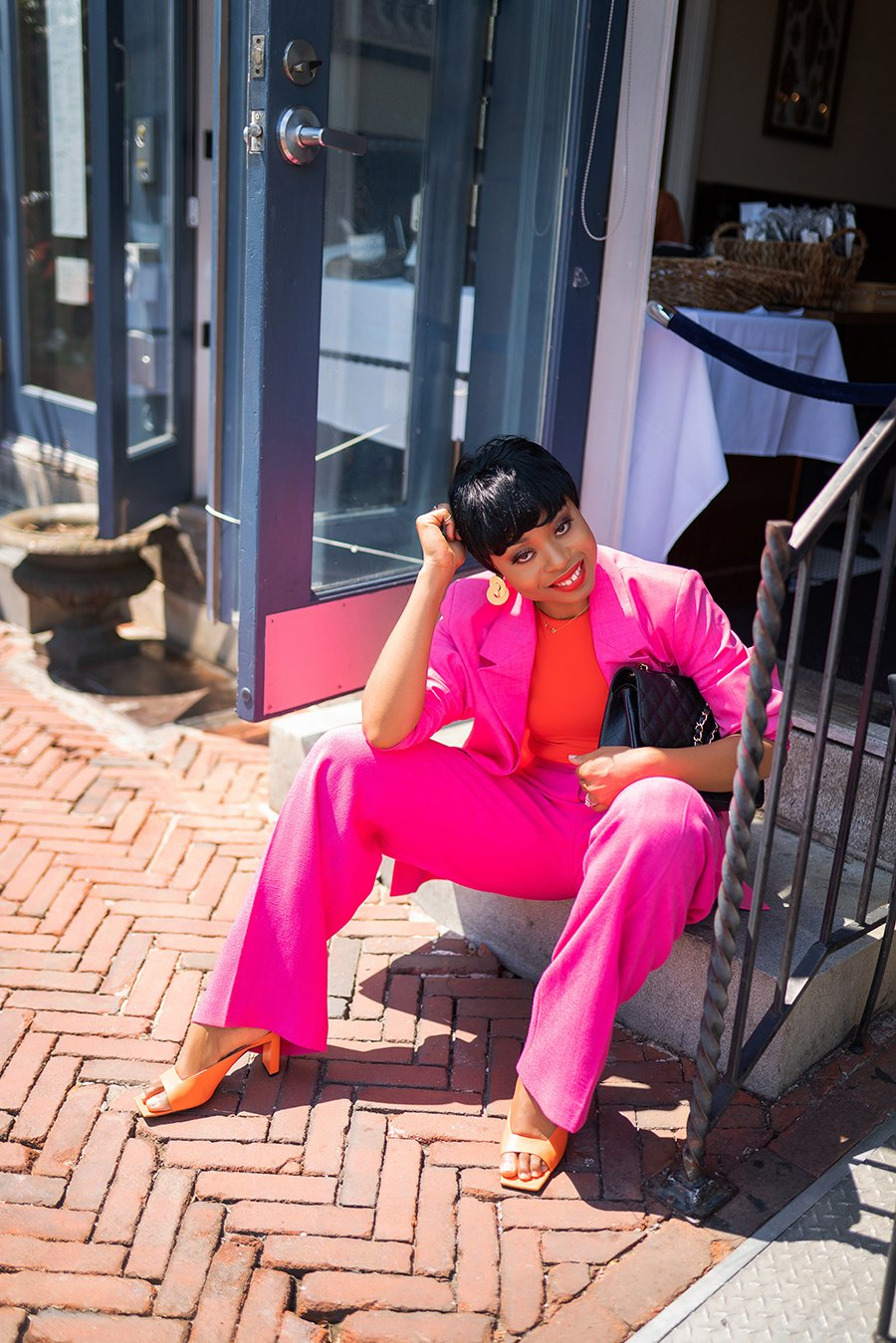 stella-adewunmi-of-jadore-fashion-blog-shares-how-to-wear-pink-and-orange-color-fells-point-baltimore