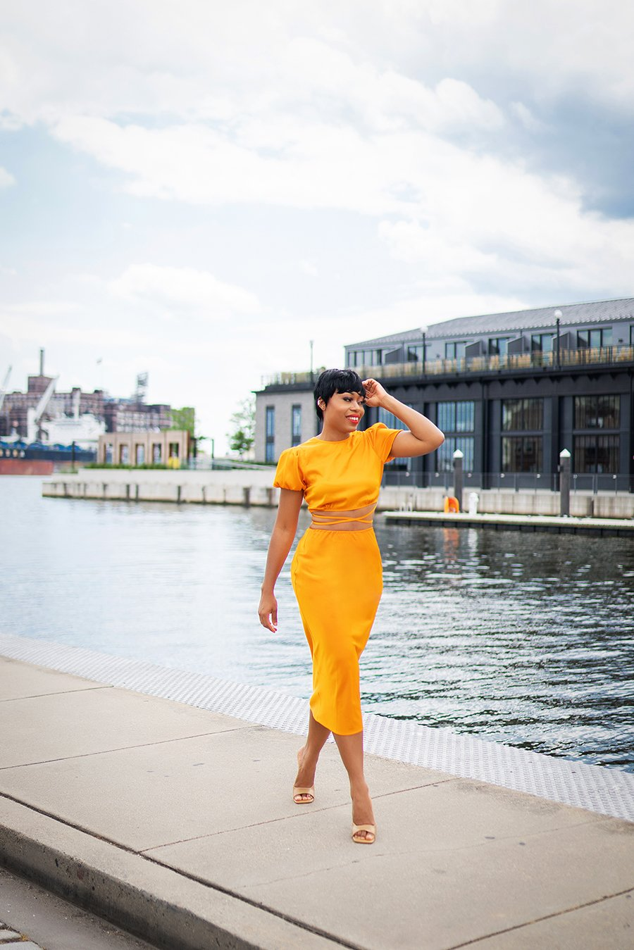 stella-adewunmi-of-jadore-fashion-blog-shares-how-to-wear-the-color-orange-in-wayf-crop-top-skirt-baltimore-fells-point