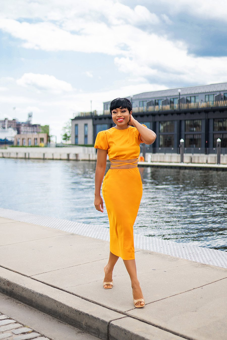 stella-adewunmi-of-jadore-fashion-blog-shares-how-to-style-the-color-orange-in-wayf-crop-top-skirt-baltimore-fells-point