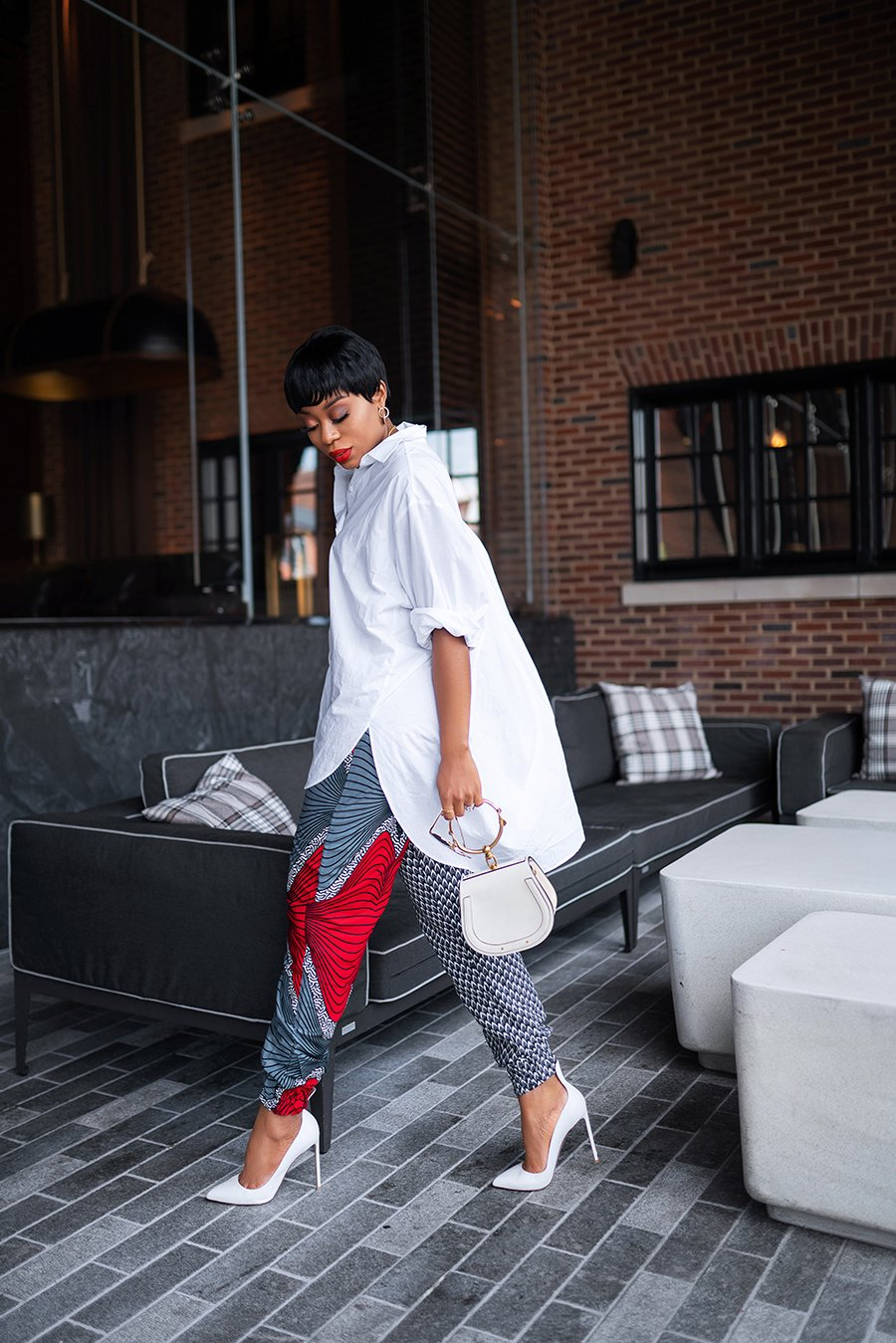 stella-adewunmi-of-jadore-fashion-blog-shares-chic-way-to-wear-ankara-joggers-oversized-white-shirt-white-pumps