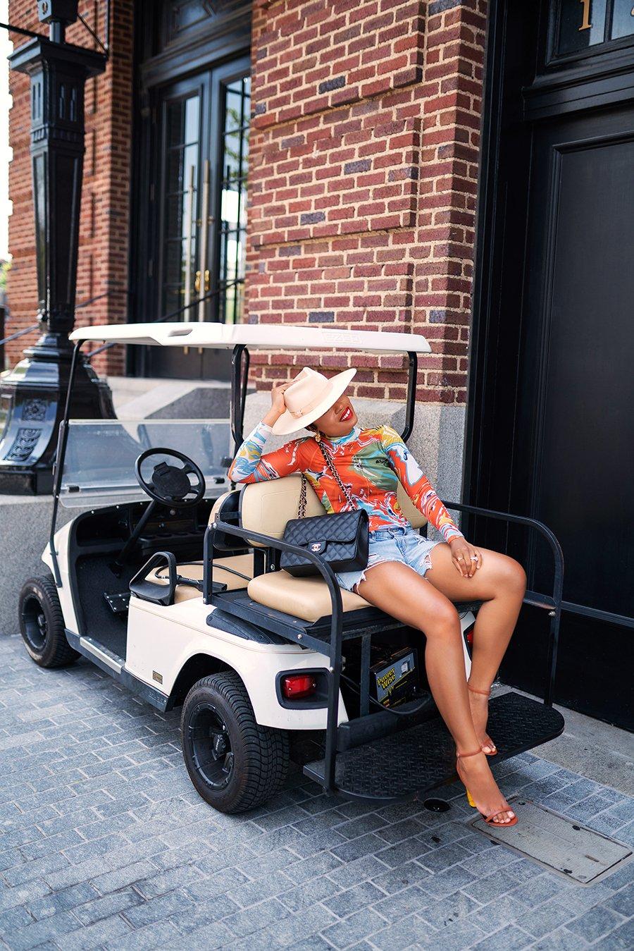 stella-adewunmi-of-jadore-fashion-blog-shares-summer-shorts-denim-shorts-vacation-style
